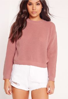 Up your basics and feast your eyes on this fine knitted jumper. Featuring a playful mauve hue and crew neck style, this is a seasonless piece to seriously up your day game. Match with dark, ripped denim shorts and black ankle boots for a dr...