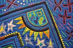 One of my favorite exhibits at Salon Pour l'Amour du Fil 2015 in Nantes, France was a jaw-dropping display of molas by Japanese artist F...
