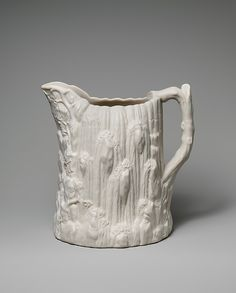 United States Pottery Company | Pitcher | American | The Met Pitcher  Maker:United States Pottery Company (1852–58) Date:1852–58 Geography:Made in Bennington, Vermont, United States Culture:American Medium:Parian porcelain Dimensions:10 x 11 1/2 x 7 1/2 in. (25.4 x 29.2 x 19.1 cm)