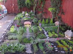 Love the idea of a big miniature garden! Just needs spaces for children to move around in it and sit to play