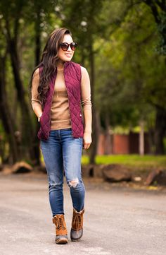 cute & little blog | petite fashion | sorel winter fancy lace ii, plum puffer vest, camel tippi sweater, distressed jeans | fall winter outfit