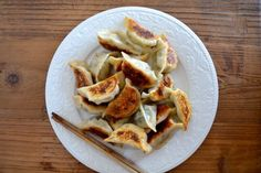 We've been making this dumpling recipe for a long time. A LONG time. I remember sitting on a stool in my grandmother's kitchen on 161st Street in Queens, learning to fold these…my seven-year-old fingers clumsily stumbling over everything…getting the wrappers way too wet, putting in too much filling, and crossing my fingers by the stove in a futile attempt to keep them from opening up while they cooked.
