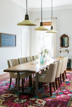 This cozy and eclectic dining room with a reclaimed wood table is the perfect place to host a dinner party.