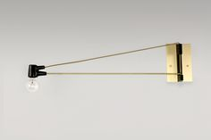 Brassy Cord Sconce // Black Socket, Brass Wire, Brass Arm with Brass Wallplate http://www.brendanravenhill.com/products/cord-sconce