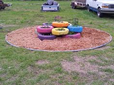 Herb garden using recycled tires and an old trampoline mat and frame for circle.  Saw tires on another pin with flowers.