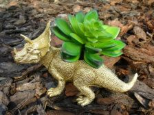 Love this gold dinosaur (Planters in Garden & Outdoors - Etsy Spring Celebration)s