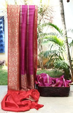 Bright purple with fine silver and gold vertical woven design across the body and a rich red and gold border and pallu add to the beauty of this tussar south silk.