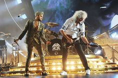 "Adam Lambert and Brian May perform in Chicago June 19th, 2014.  Rolling Stone review:  ""Queen and Adam Lambert's Tour Opener:  5 Things We Learned.""  Regal rock band and their new frontman make a grand U.S. debut at Chicago's United Center..."