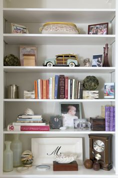 I love the built-ins on either side of our fireplace. Photography: Michelle Drewes