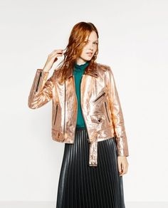 Add some glimmer to an outfit by throwing this metallic leather jacket on.