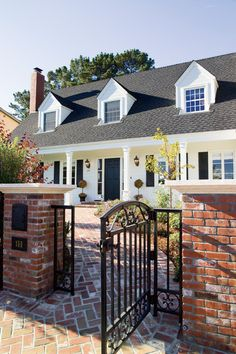 Red brick sidewalk.       House in the Hamptons traditional exterior