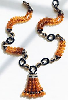 Amber beads and onyx links make for the perfect autumnal tassel necklace! Coral Jewelry, Black Jewelry, Amber Jewelry, Gems Jewelry, High Jewelry, Beaded Jewelry, Jewellery, Beaded Statement Necklace, Tassel Necklace