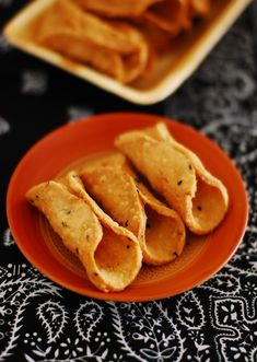Kuzhalappam. Savory deep-fried rolled snack with rice flour, onion and garlic, and coconut.