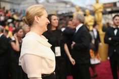Meryl Streep  (Don Gummer in background (R))- Arrivals at the 86th Annual Academy Awards —2014
