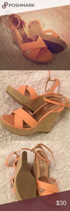 Pink Madden girl wedges Orange pink peachy color straps. Wore them a couple of times. Size 7 Madden Girl Shoes Wedges