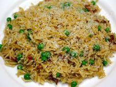 ORZO CARBONARA-STYLE (bacon, chicken stock, cream, Parmesan, thyme, peas)