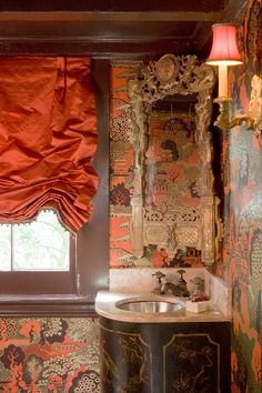 Darling, I've fallen in love with tangerine. How do you like the little  powder room upstairs with this pretty wallpaper....................Glam, yes?