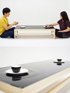 'Ripple Effect Tea Table' installation by industrial designer jeonghwa seo is a reflection of eastern mentality towards social relationships. Ripples are created on the top water layer of the table surface everytime the tea cup   and saucer are moved by the user.
