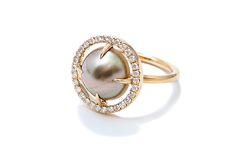 Gemstone Spotlight: Jordan Alexander. This 18-karat gold ring features a round Tahitian pearl slice framed in pave diamonds ($3,519).