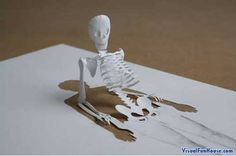 3d drawings on paper | Skeleton Rising form the paper - paper art.