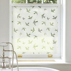 Apply window film for privacy for a modern alternative to a sheer panel then dress with a pelmet, blind or curtains.