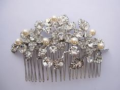This simple and elegant, bridal rhinestone and Swarovski ivory pearl hair comb is a perfect compliment for the wedding party and can easily fit into