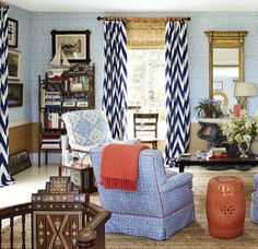 Navy chevron curtains, Chinese garden stool,  grasscloth wallpaper, possibly  Syrian / Moroccan inlaid chair, Quadrille/ china seas new batik (on chair facing out), bamboo blinds