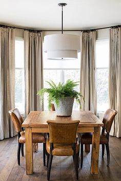 Rustic dining room + neutral window treatments +metal and leather dining chairs + layered drum chandelier + rustic wood dining table Rustic Dining Chairs, Leather Dining Room Chairs, Rustic Chair, Dining Table, Rustic Wood, Dining Rooms, Antique Chairs, Wood Table, Kitchen Dining