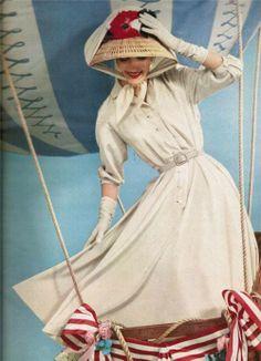 ivory crepe shirtwaist dress with great summer hat. May Vogue 1957 #1950sfashion #50sdresses #shirtwaistdress