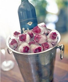 Frozen Rosebuds- perfect ice for chilling champagne! Have to remember this!
