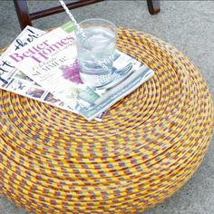 Want an ottoman you can use outdoors that looks high-end but doesn't come with the hefty price tag? This DIY rope tire ottoman is the perfect solution. Plus, you'll be upcycling an old tire that otherwise wouldn't have had a second life. #diy #ottoman #tireottoman