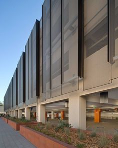HOOVER GARAGE - Anodized aluminum solar shading / for facade / vertical / perforated by A. Factory Architecture, System Architecture, Facade Architecture, Parking Building, Building Facade, Building Design, Building Skin, Garage Design, Exterior Design