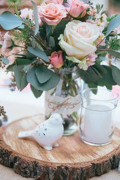 wood slice centerpiece, photo by Sue Wheelock Photography http://ruffledblog.com/san-juan-capistrano-wedding-with-handmade-touches #centerpieces #weddingideas