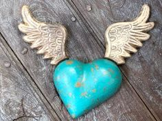 Including wings high x wide. A beautiful winged heart from Mexico handcrafted by skilled artisans. They have a small hole in the back to hang on the wall, or you can hang them from the ceiling. Turquoise Furniture, Heart Wall, Artisan, Wings, Mexico, Ceiling, Unique, Crafts, Beautiful