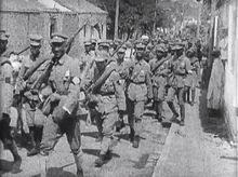 NRA soldiers marching, During the Chinese Civil war which raged between August 1st 1927 to December 22nd 1936.then began again in March 31st 1946, the war ended with the communist victorious in May 1st 1950.