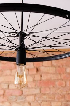 Handmade Industrial hanging bike wheel lamp minimalist simple by GoodLights on Etsy