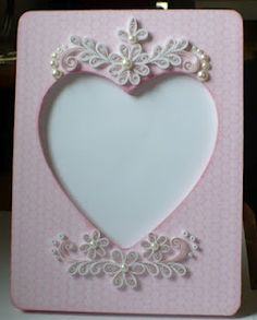 quilled paper and pearl frame embellishments