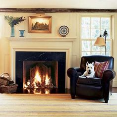 A cozy #farmhouse living room and loyal Fido standing by (ahem, sitting in YOUR favorite chair). #puppylove | Photo: Jurgen Frank | thisoldhouse.com