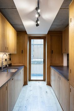 This ground floor contains kitchen and dining areas that open onto outdoor terraces. London Townhouse, London House, London Brick, British Architecture, Timber Windows, Oak Panels, House Elevation, Brickwork, House Floor Plans