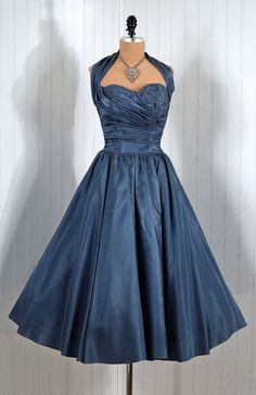I have ALWAYS wanted a dress like this. In a deep blue /red. ~le sigh