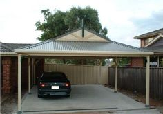 Freestanding dutch gable roof carport with corrugated colorbond roof.