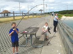Family fishing together on the pier at Kiptopeke State Park, Virginia