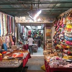 Temple Street market, Hong Kong.  I love shopping here!! with Margaret and Fanny