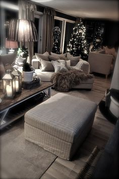 Love this furniture and design. (Minus the Christmas decor.) It looks so inviting.