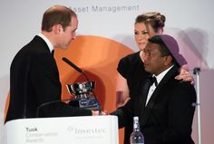 Prince William, Duke of Cambridge presents the Tusk Award For Conservation in Africa Award to Herizo Andrianandrasana during the Tusk Conservation awards at Claridges Hotel on November 25, 2014 in London, England.