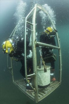Navy Diver 2nd Class Octavio Alvarez, left, watches for the sea floor as he and Navy Diver 3rd Class James Lindley descend to conduct excavation of a U.S. aircraft crash site in support of an ongoing Defense Personnel Accounting Agency (DPAA) mission in the northern Adriatic Sea. #ScubaDivingEquipmentandSites