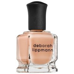 Deborah Lippmann All About That Base CC Base Coat | This CC nail treatment is formulated with a special hydrating complex infused with panthenol, which helps to moisturize, strengthen, and protect the look of nails while treatment correctors assist with concealing imperfections, brightening, priming, and filling in ridges for a smooth and matte, flawless-looking finish with improved wear.