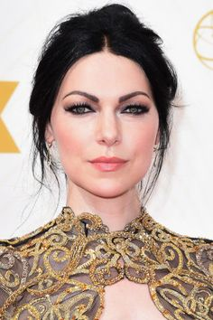 Laura Prepon's smokey eyes are perfectly blended with inky, opaque liner rimming them and complemented by ultralong, dark lashes