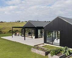 This black-clad home makes a bold statement on the outside, but inside it's warm, welcoming and designed to create the ultimate Kiwi childhood Modern Barn House, Barn House Plans, Clad Home, Rural House, Black Barn, Shed Homes, Cottage, Affordable Housing, Scandinavian Home