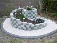 Herb spiral garden, walls, stone, garden design, planting Source by Herb Spiral, Spiral Garden, Garden Yard Ideas, Garden Projects, Diy Garden, Garden Plants, Front Yard Landscaping, Backyard Patio, Backyard Layout